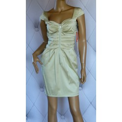 Elegancka pistacjowa sukienka zamek kieszenie
